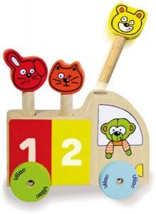 Ce jeu bois qu'on appelle un pop-up est très rigolo pour amuser bébé à coup sûr : Et hop ! On appuie sur les personnages et ils s'envolent dans les airs.
