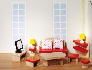 Certains accessoires permettent à l'enfant de reproduire dans sa maison de poupées en bois sa propre maison en miniature.