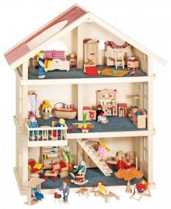 Maison de poupées en bois avec des accessoires et des personnages pour recréer un  petit monde et donner libre cours à son imagination !