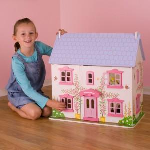Maison de poupée rose blanche et mauve avec tous ses accessoires est un jouet complet en bois signée Bigjigs