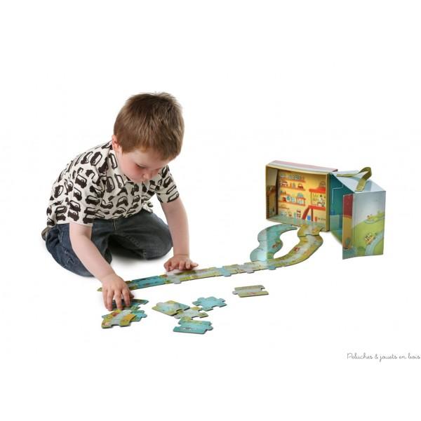 Un puzzle valise circuit route et rivière recto verso en carton laminé brillant de la marque Lilliputiens. A partir de 3 ans+