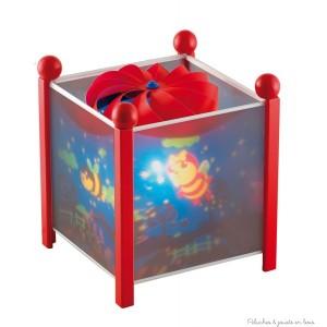 """Lanterne magique de la marque Trousselier sur le thème """"Drôles de petites bêtes"""" de couleur rouge, à partir de 0m+"""