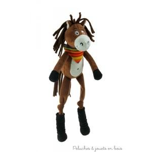 Tigalo le cheval de la marque Les Petites Marie. Tout doux avec sa belle crinière ses longues pattes et son bandana multicolore. Livré en boîte cadeau cylindrique en bois. A partir de 0m+
