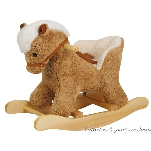 Un cheval à bascule bébé avec siège, ceinture de maintien, et fonction musicale par pression sur l'oreille, de la marque Histoire d'Ours. A partir de 1 an+