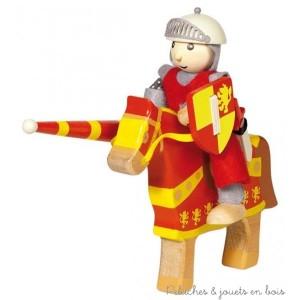Le chevalier Arthur avec son cheval rouge en bois peint est articulé et possède en plus de son armure, un heaume, une lance, un bouclier et une épée qu'il porte à la taille. Taille 11 cm. Normes CE
