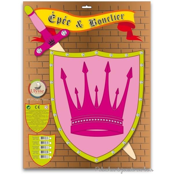 De couleur rose une épée et un bouclier de princesse en bois. le bouclier est muni d'une poignée pour une bonne prise en main. Epée 57 x 15 x 2 cm Bouclier 34 x 28 cm. Normes CE