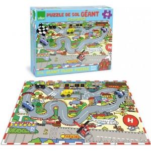 Un puzzle de sol géant course de voiture de 48 pièce en carton épais signé Vilac. A partir de 4 ans+ Il permet de créer un circuit de course et une piste d'aéroport pour jouer avec ses petites voitures et ses avions. (accessoires non inclus). Dimensions : 92 x 62 cm Normes CE