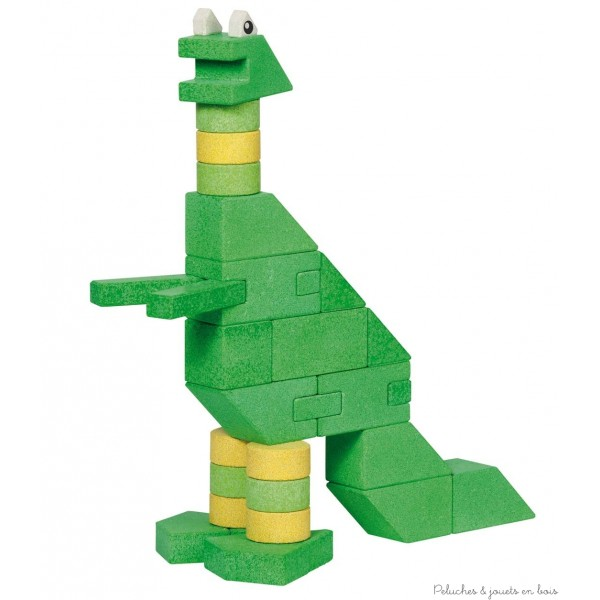 Une grande boite de construction dinosaure Brontomos de 105 éléments en pierre dans une boîte en bois. Il est possible de réaliser au moins deux grands dinosaures avec ce kit de construction. Fabriqué en Allemagne à partir de matières premières naturelles. Normes CE