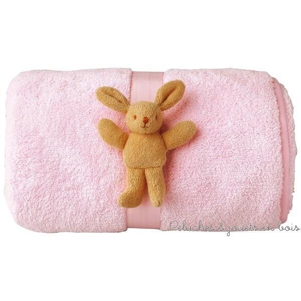 Couverture douce de la marque Trousselier de couleur rose, 65x90cm, avec peluche lapin, adaptée aux tout petits dès la naissance.