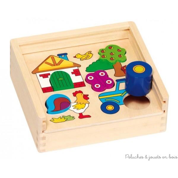 Boite à formes et puzzle ferme à encastrer 2 en 1 aux couleurs vives de la marque Goki. A partir de 1 an+