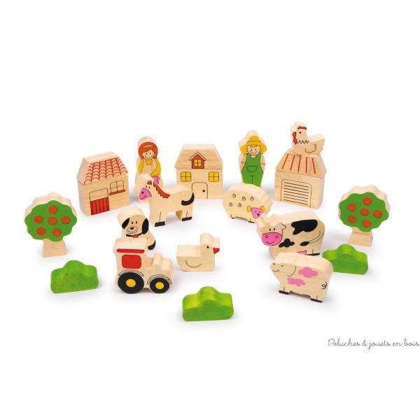 Un jeu de construction ferme en bois de hêtre de 22 pièce représentant des animaux, des bâtiments et personnages de la ferme. A partir de 1 an+