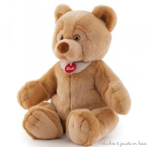 Un bel ours en peluche de couleur beige moyen de 49 cm, expressif et câlin Théo de la marque trudi. Tous âges.