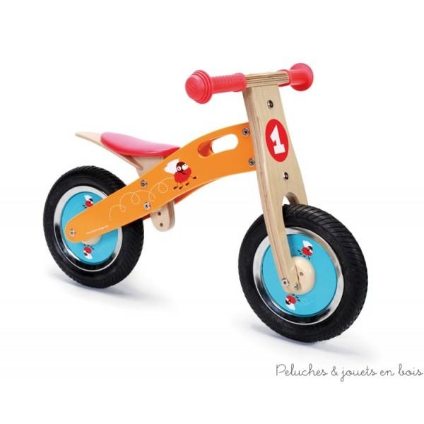 Une draisienne de la marque Scratch décorée d'une petite mouche casquée intrépide, prête à gagner toutes les courses pour une transition facile et agréable vers un véritable vélo. A partir de 2 ans+