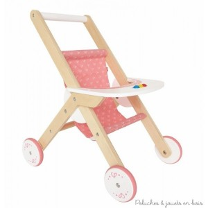 Une poussette en bois pour poupée avec roues silencieuses de couleur bois naturel, blanc et rose de la marque Hape. A partir de 3 ans+