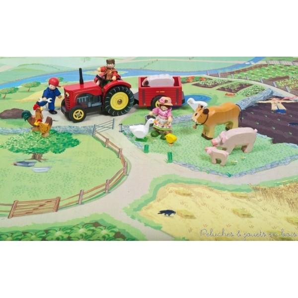 Un tapis de jeux ma ferme de la marque Le Toy Van. Un petit coin de campagne parfait pour installer une jolie ferme ou jouer à de nombreuses activités agricoles. On y retrouve des champs de cultures, des potagers, des enclos pour les animaux, une mare, une rivière et de nombreux chemins....A partir de 3 ans+