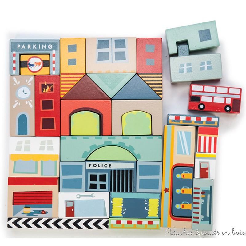 Un ensemble de 34 blocs en bois peints sur le thème de la ville, pour construire et créer ses propres histoires ou compléter les univers des tapis de jeu. Jouet en bois peint conçu en Grande Bretagne et produit en Indonésie suivant des lignes éthiques de travail et écologique pour le renouvellement des matières premières. Normes CE