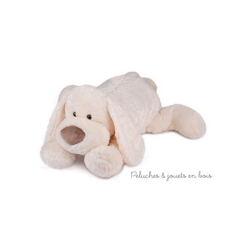 Un chien blanc classique Cookie de grande taille 70 cm de la marque Histoire d'Ours qui n'attend plus qu'à jouer et à être câliné. A partir de 0m+