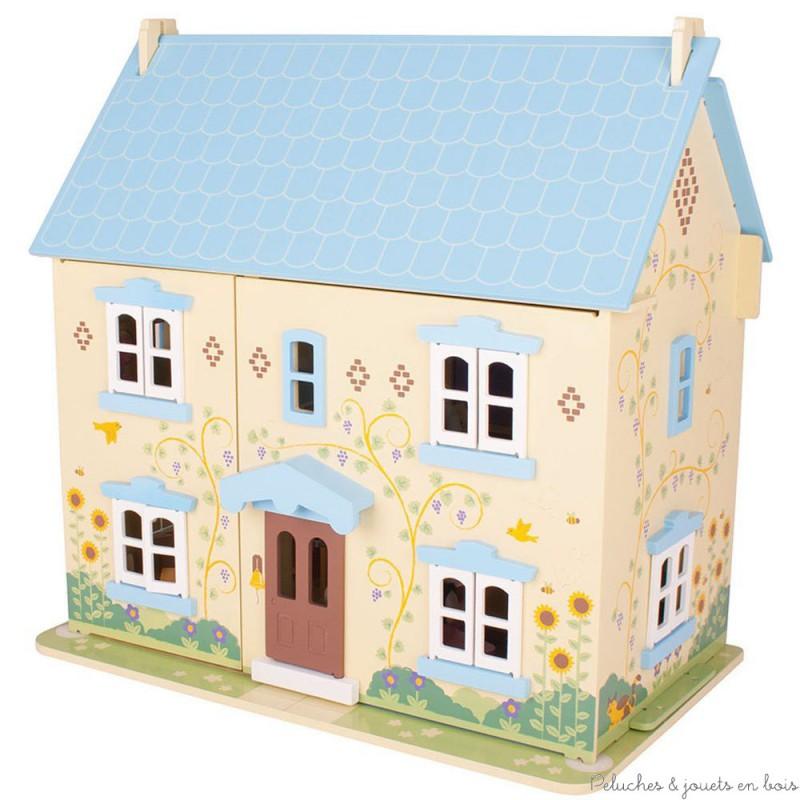 Une grande et jolie Maison de poupées bleue Sunflower en bois de la marque Bigjigs entièrement meublée et habitée par une petite famille, un chien et un chat. Décoration personnalisable grâce a une planche de stickers. A partir de 3 ans+