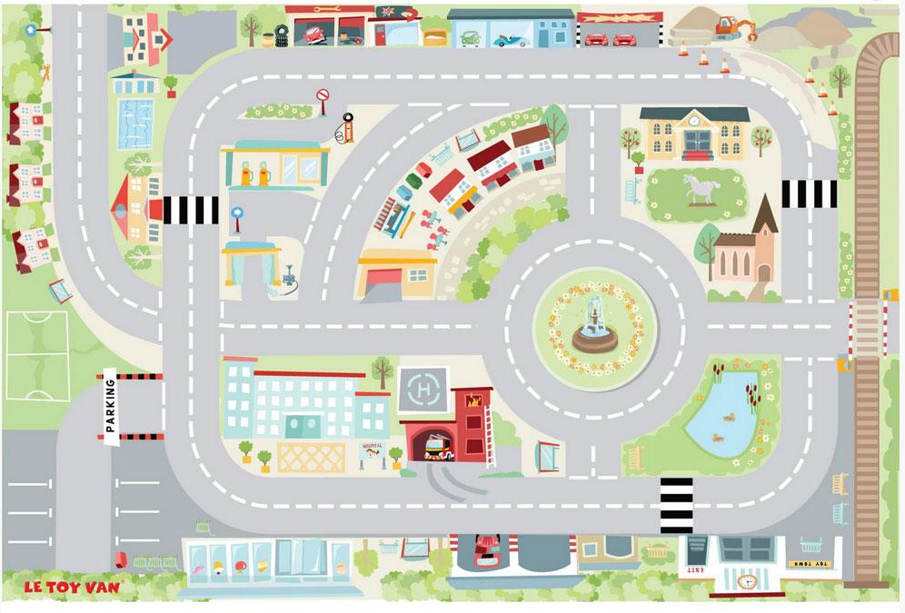 Un tapis de jeux ma première ville de la marque Le Toy Van. Avec ce tapis fabuleux on découvre tout un petit univers le long des routes, caserne des pompiers, garage, hopital, mairie, zone résidentielle et commerciale... A partir de 3 ans+