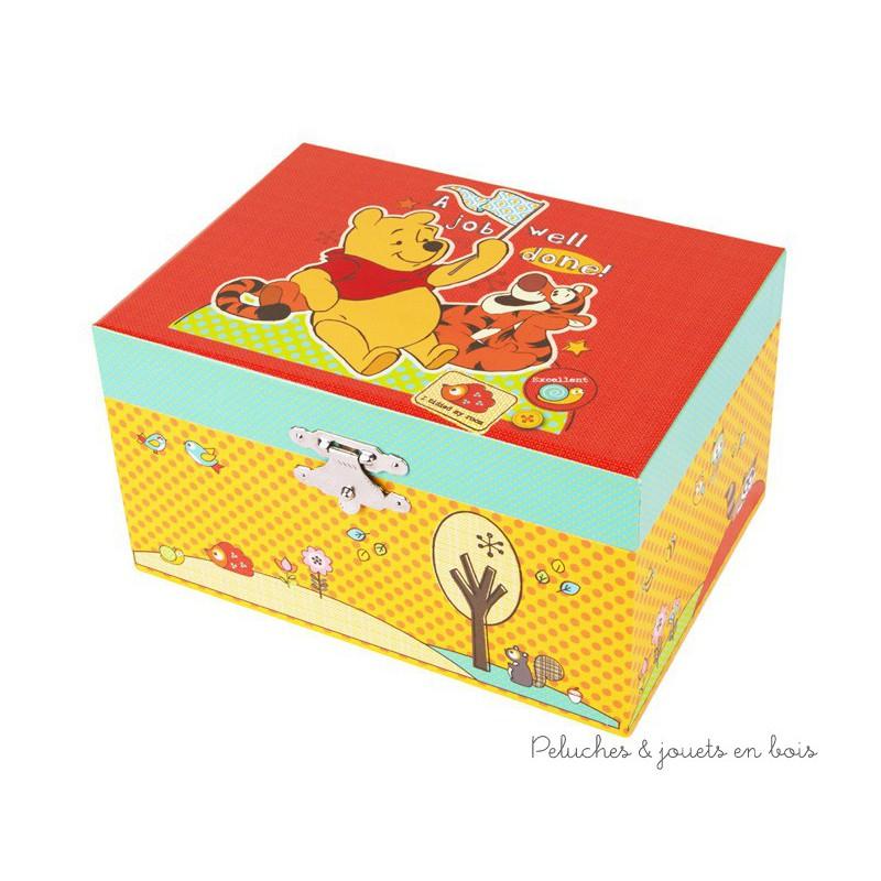 Une boite à musique orange de la marque Trousselier sur le thème Winnie l'Ourson. Musique Beautiful Dreamer. A partir de 2 ans+