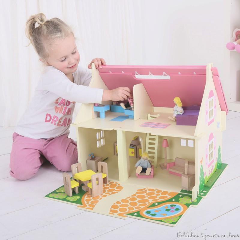 Cette jolie petite maison de poupées rose en bois de la marque Bigjigs, comprend 18 pièces de meubles, une famille de 4 poupées articulées en bois + chien. A partir de 3 ans+