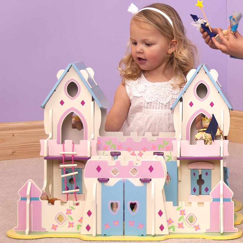 Ce chateau de princesse blanc, rose et bleu de la marque Bigjigs est une maison de poupée féérique qui comprend 6 personnages en bois articulés. A partir de 3 ans+