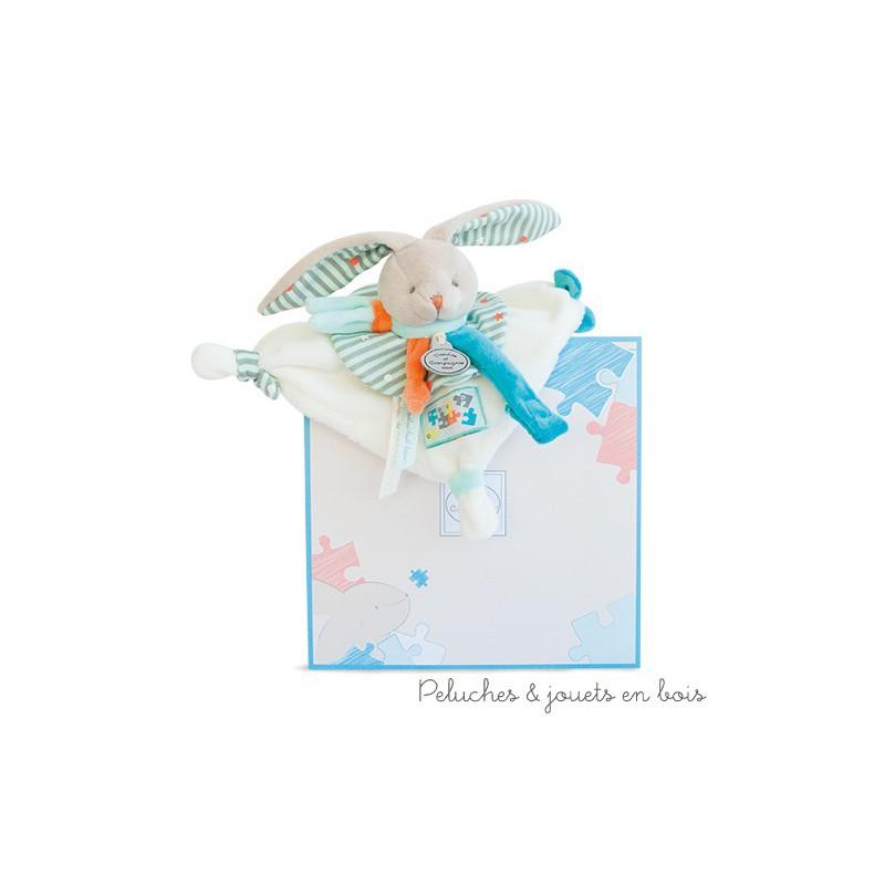 Un amour de doudou Lapin Happy avec un attache sucette velcro de la marque Doudou et Compagnie. A partir de 0m+