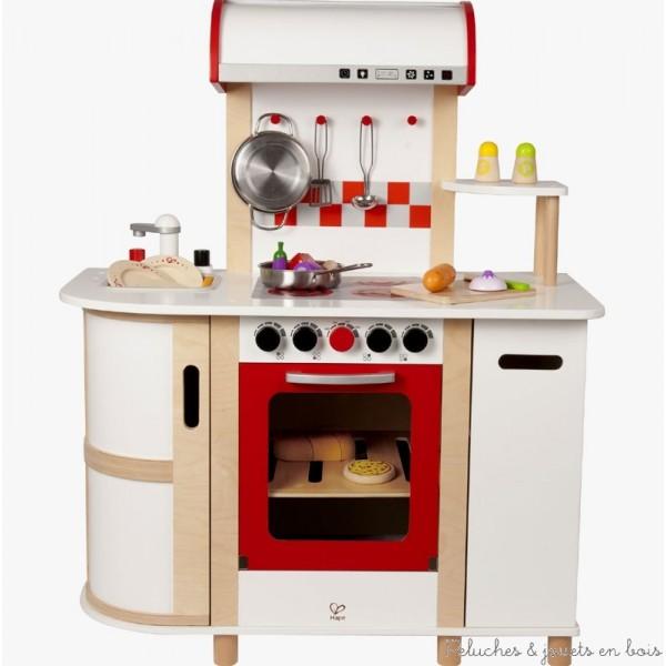 Cette cuisine incite à jouer collectivement. Faîtes un jeu de rôle avec votre enfant. L'armoire peut servir de réfrigérateur. Les éléments de cuisine visibles sur la photo avec les enfants, (dinette en bois, aliments...) sont vendus séparément. Dimensions : 75.7 x 39 x 93.5 cm. Peintures non toxique à base d'eau, bois FSC.Normes CE. Ce jouet en bois fait partie de la collection Playfully Delicious de dinette en bois et de cuisine en bois jouet signée Hape, comme tous les autres jouets suivants de cette collection qui sont vendus séparemment dans notre boutique : Cuisine multifonction, Cuisine gastronomique verte, Cuisine du chef, La tour des dessert, Robot de cuisine avec sac à farine et sucre Hape, Salade du jardin Hape, Le choix du chef, Set machine à café Hape, Alimentation saine,Kit pizza, Cuisinière plaques et gril repliable, Ensemble du petit dejeuner grille pain Hape, Assortiment de sushi, Dinette en bois Hape, Dinette service à thé, Ensemble fondue au chocolat, Set de brochettes de dinette, Set de déjeuner, Set de fruits à découper Hape, Set de légumes à découper Hape, Set hamburger et hot dog Hape...