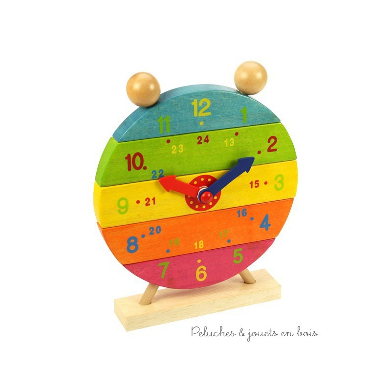 Jolie horloge coloré et décorative et jeu à empiler de la marque Bigjigs pour apprendre l'heure tout en s'amusant. A partir de 3 ans+
