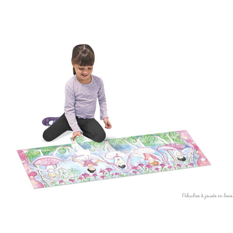 Un très joli puzzle géant de sol de 48 pièces, de plus d'un mètre de long représentant une illustration de 5 ballerines de la marque Mélissa & Doug. A partir de 3 ans+