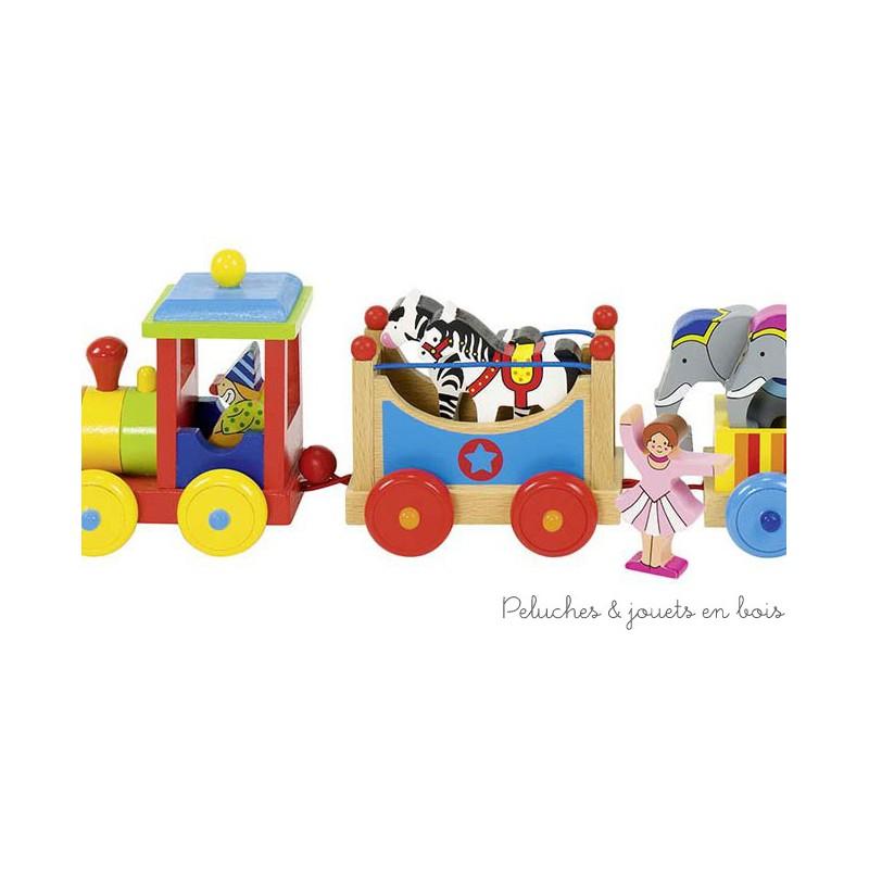 Le train du cirque Livorno en bois verni avec 1 locomotive, 3 wagons et 9 figurines en bois vernis de la marque Goki. A partir de 3 ans+