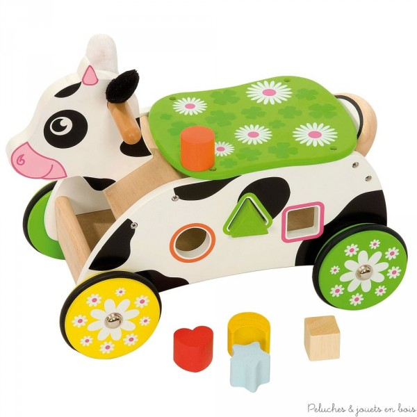 Un porteur en bois vache avec de jolies petites oreilles en peluche et une boîte à formes de la marque Bigjigs. A partir de 1 an+