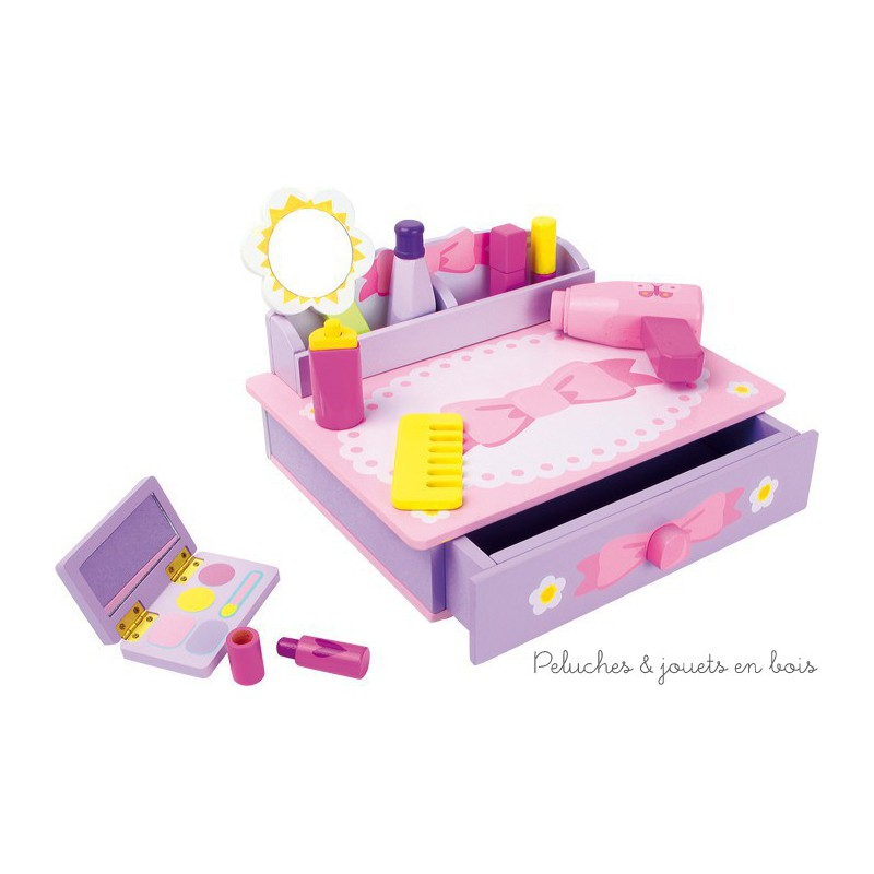 """Une coiffeuse ruban rose et mauve en bois contenant tout un ensemble pour se coiffer et se maquiller """"pour de faux"""" pour se faire belle comme maman. A partir de 3 ans+"""