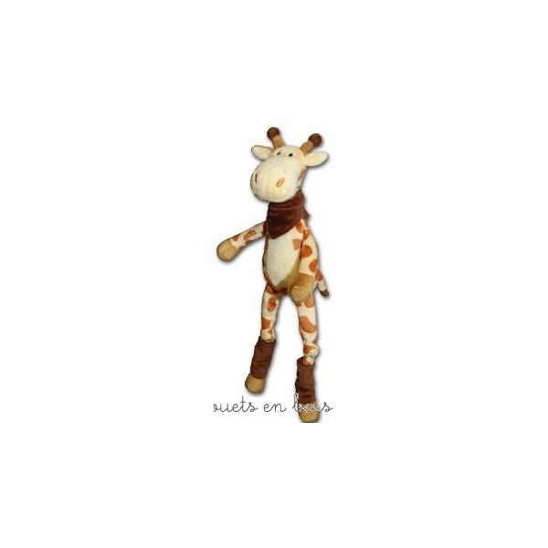 Olaf la girafe, peluche de la marque Les Petites Marie, doudou avec de longues pattes et un bandana. Livrée en boîte cylindrique. A partir de 0m+