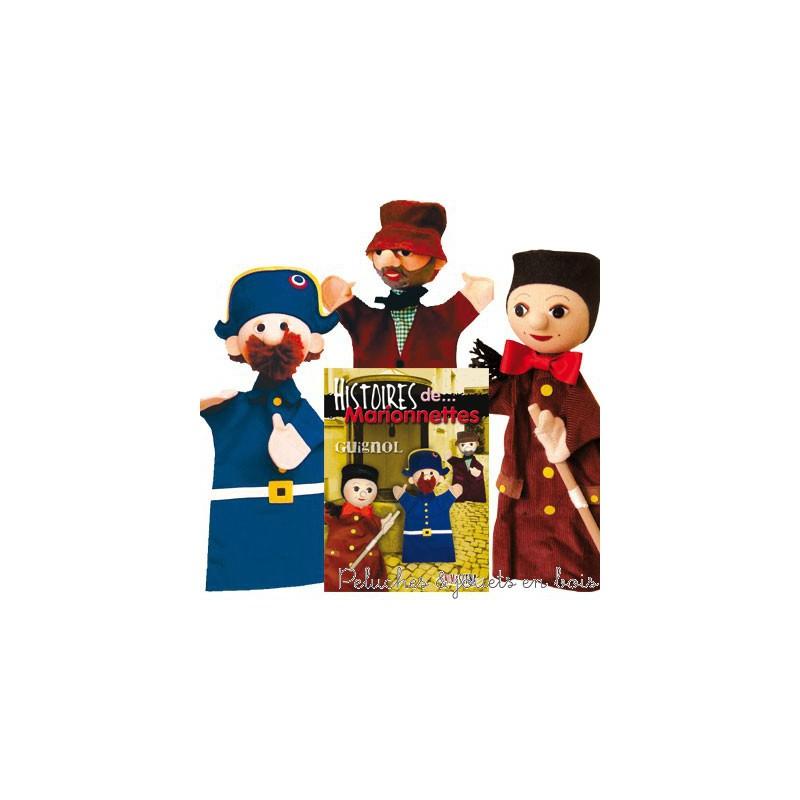 Un trio de Marionnettes Guignol, signée Animascena - Le Coin des enfants,composé de 3 marionnettes à main en tissu avec une tete dur et un livret dans un coffret de présentation. A partir de 4 ans+