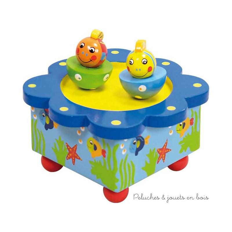 La boîte à musique en bois poisson de la marque Ulysse Couleurs d'Enfance, est ludique mais c'est aussi une excellente idée pour la déco de la chambre. A partir de 3 ans+