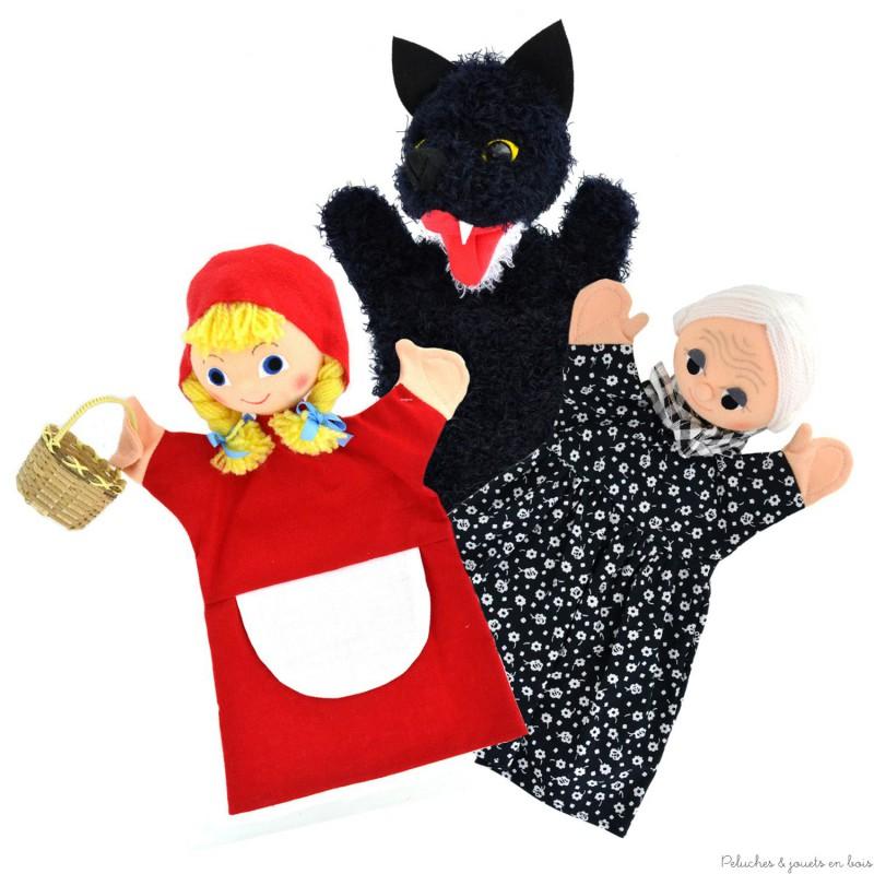 Un trio de Marionnettes Le Petit Chaperon Rouge, signée Animascena - Le Coin des enfants,composé de 3 marionnettes à main en tissu avec une tête dure et un livret. A partir de 4 ans+