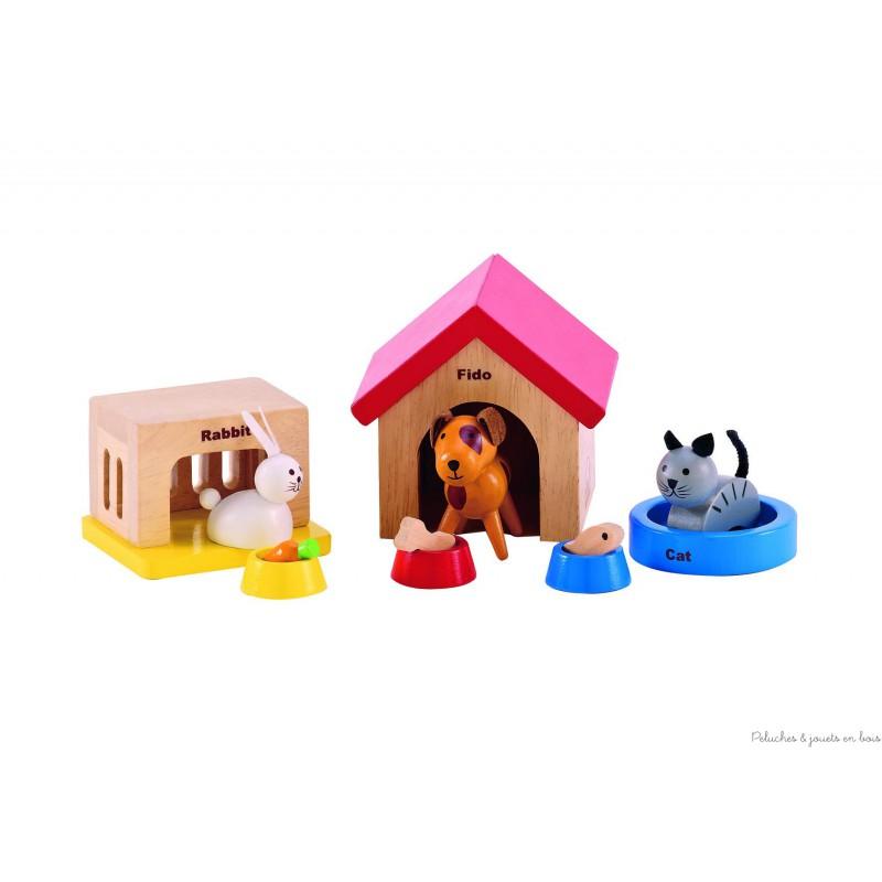 Un ensemble d'animaux domestiques avec leur gamelle : chat dans son panier, chien avec niche, lapin dans son clapier, jouet en bois signé Hape, à partir de 3 ans+